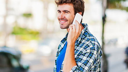 man on cell phone smiling