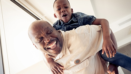 African american father and son smiling